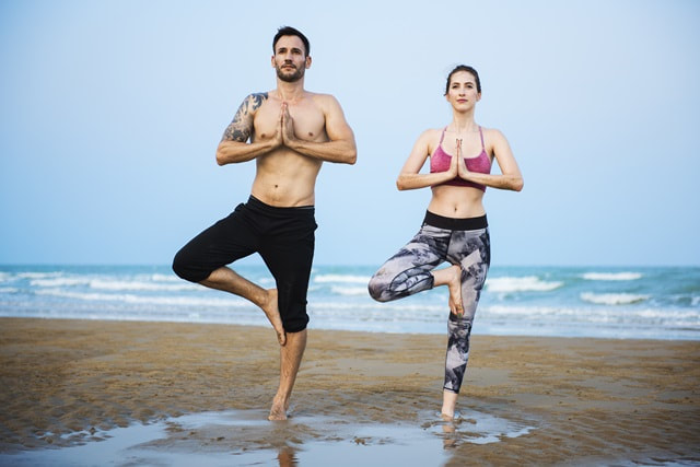 Two people in yoga poses